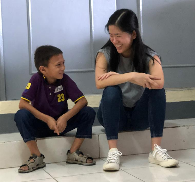 Mika Ley shares a laugh with a student in Manila.