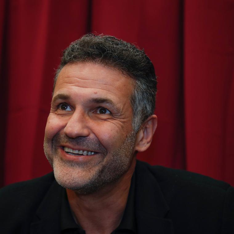 Khaled Hosseini smiling image link to article