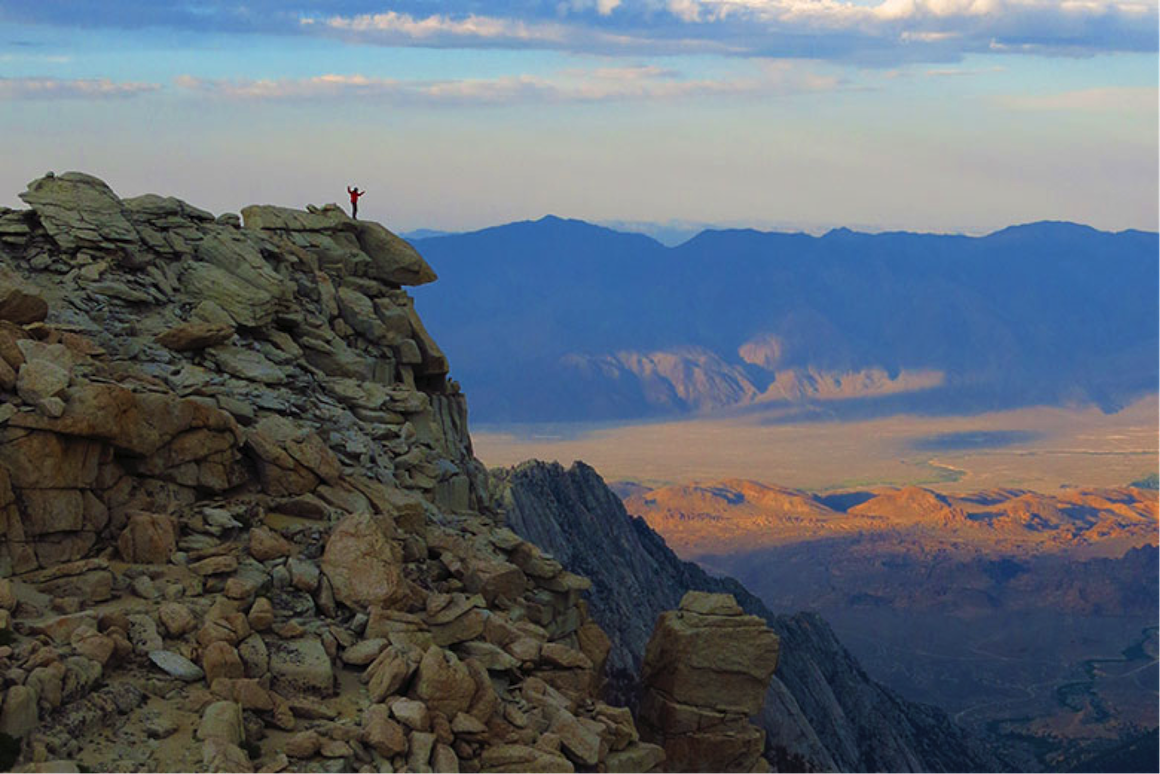 ESS Senior Sean Reilly takes in the view from high in the Eastern Sierra. Mix and Reilly are developing climate records to determine if the southern Sierra rose more recently than the north side and explore the interaction between uplift and changes in atmospheric circulation. image link to story