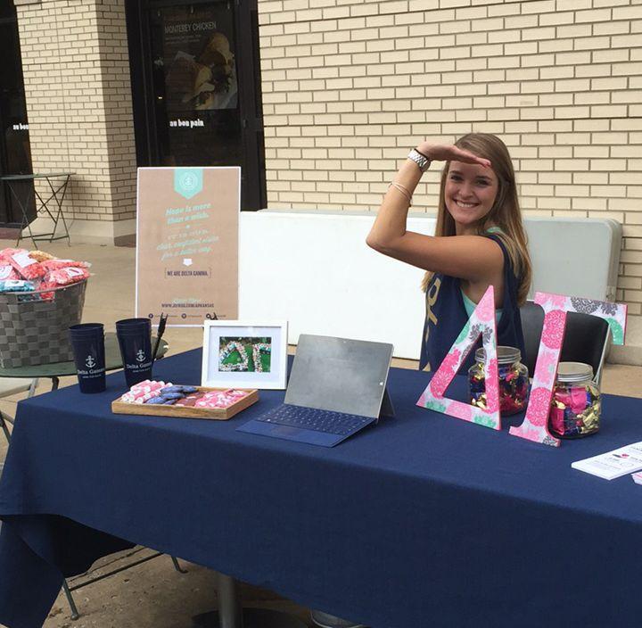 Allison Byrne at the Delta Gamma table at the University of Arkansas. image link to story