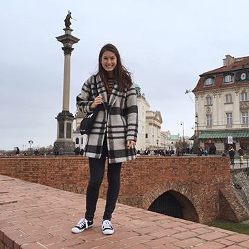 Emma on top of the castle wall in front of Sigismund III column in Warsaw.