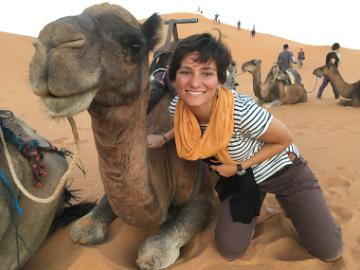 Laura and a friend in the Sahara desert image link to story