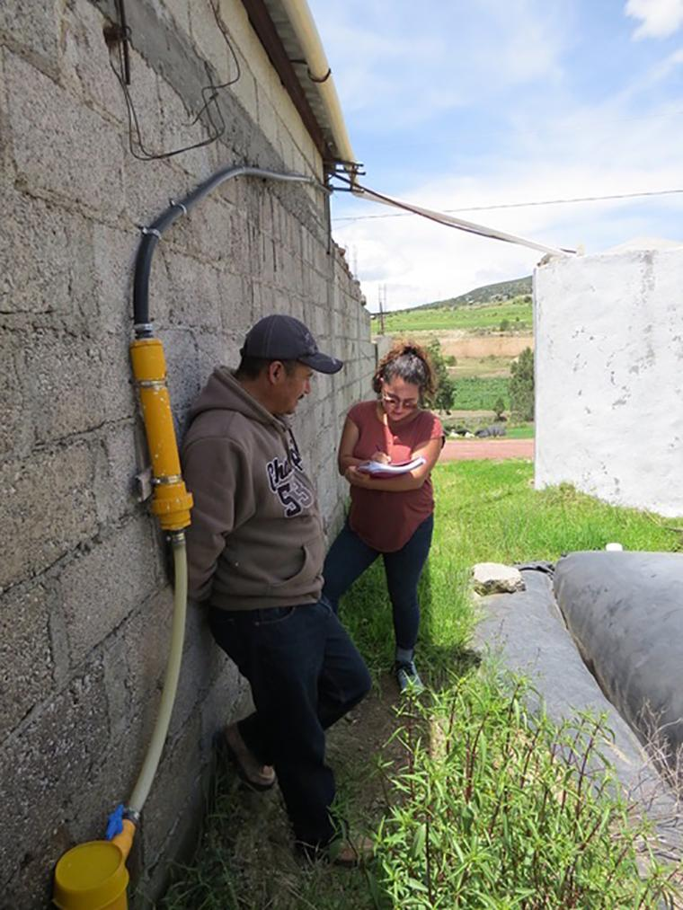 Julieta is interviewing a customer on his farm in Tlaxcala