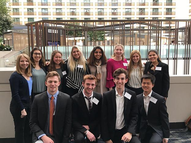 Twelve students at the Model United Nations of the Far West Conference