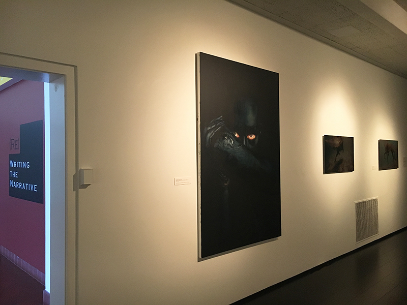 Installation image showing a painting and two photographs on gallery wall.