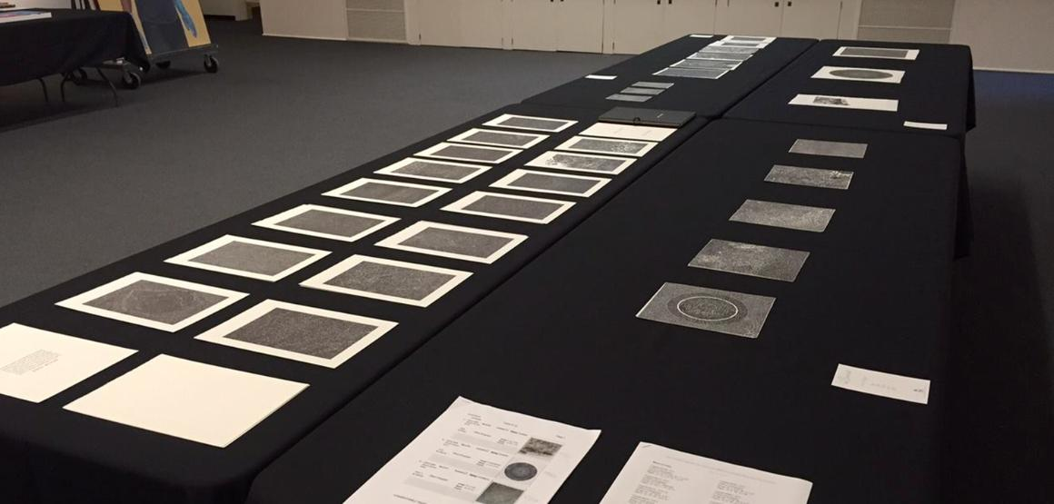 Bruce Conner prints laid out for consideration during a Collections Committee meeting.