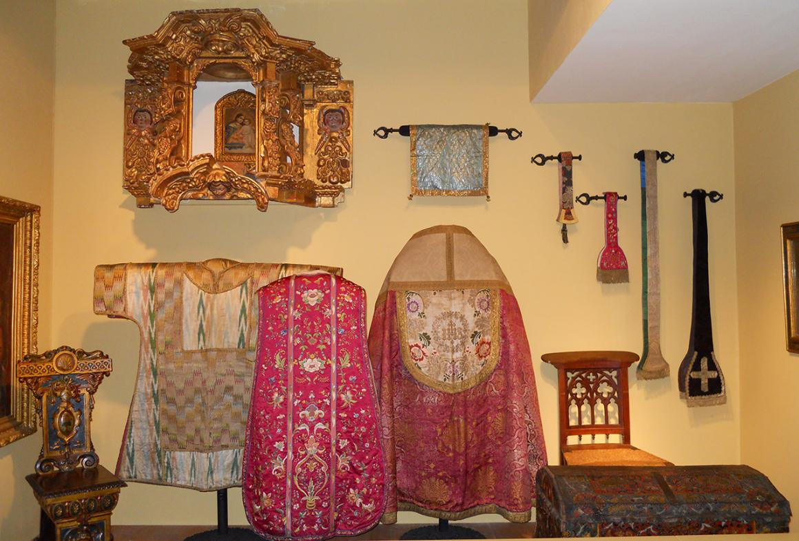 A selection of vestments of different types and patterns from the museum's collection.