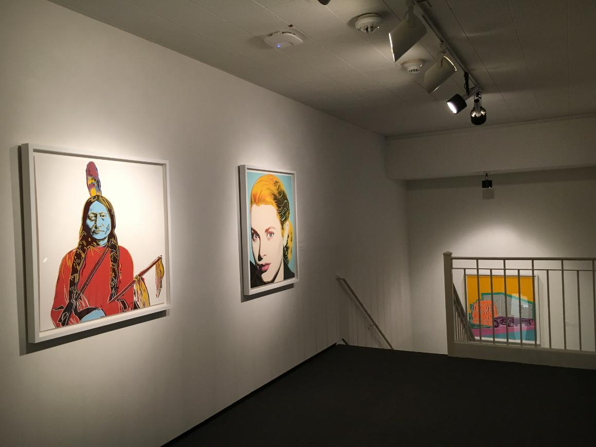 Installation view of three screenprints by Andy Warhol.