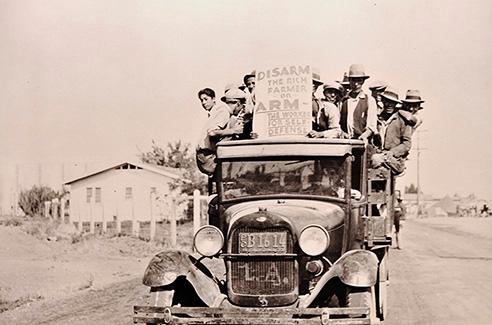 New Deal era image of protesters crowded on the back of a pick-up.