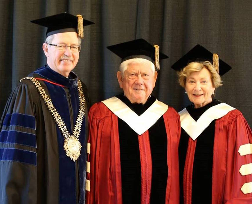 University President Michael Engh, S.J., with Mike and Mary Ellen Fox
