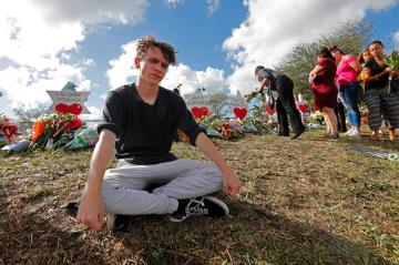 Student at a memorial outside Marjorie Stoneman Douglas High School (AP Photo/Gerald Herbert