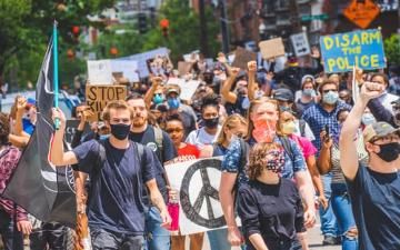 cell phone video captures image of crowd of peaceful protest march