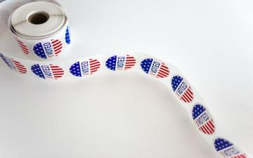 roll of red, white, and blue pattern stickers with printed with