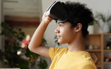 photo of boy holding a vr headset