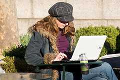 Woman using a laptop outside image link to story