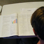 Student reading text book image link to story