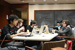 Students in a classroom working on laptops image link to story