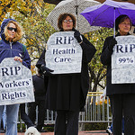 Women holding up signs image link to story