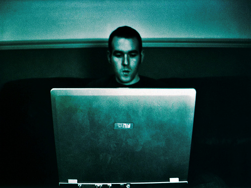 Young man staring at a computer screen image link to story