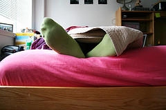 College student lying in bed image link to story
