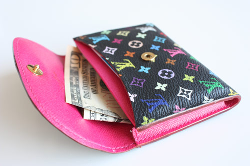Wallet with a 10 dollar bill inside image link to story