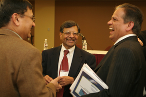 Jagdish Sheth, center, chats with conference participants