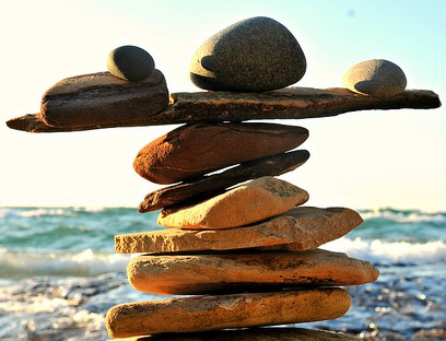 Photo of rocks balanced on each other on a beach