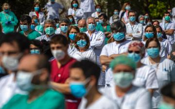 crowd of healthcare workers wearing medical mask