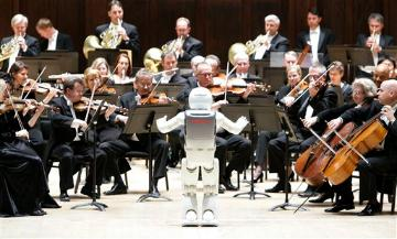 Honda's ASIMO robot conducts the Detroit Symphony Orchestra as it performs