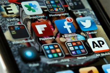 Social media apps. (AP Photo/Evan Vucci, File) image link to story