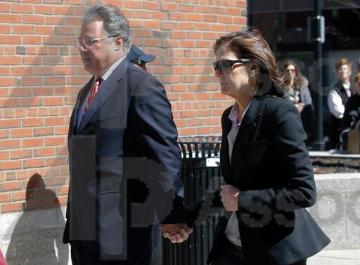 Manuel and Elizabeth Henriquez arrive at federal court in Boston on Wednesday, April 3, 2019, to face charges in a nationwide college admissions bribery scandal. (AP Photo/Steven Senne). image link to story