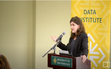 Irina Raicu speaks at podium at CADE Conference in November, 2019 image link to story