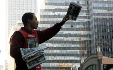 Man passing out newspapers