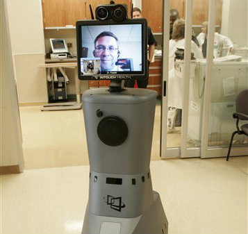 The RP-7 remote presence robotic system at St. Joseph Mercy Hospital in Pontiac, Mich. makes the hospital's specialists available around the clock to any hospital in the state. (AP Photo/Paul Sancya)