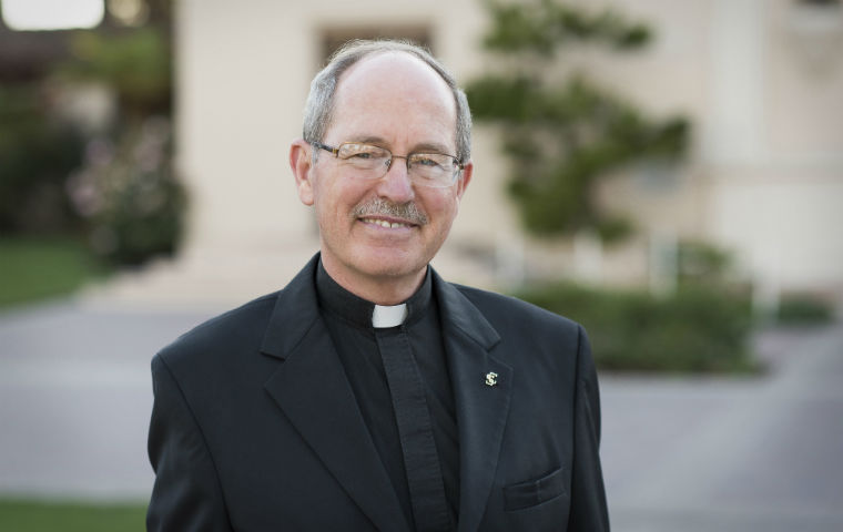 President Michael Engh, S.J., in clerical collar image link to story