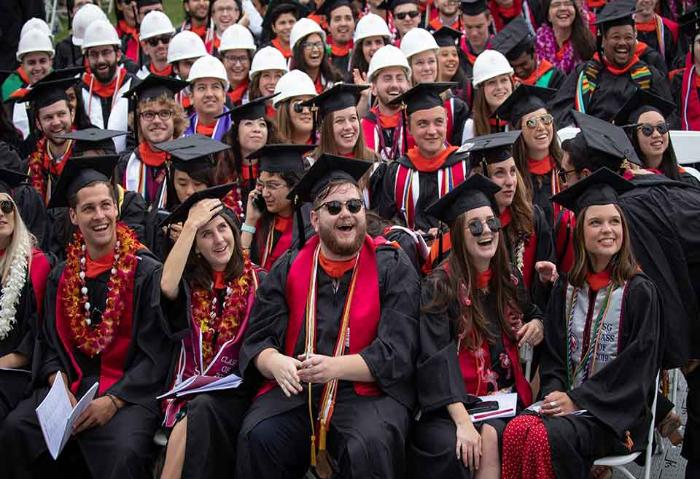 SCU students celebrating at commencement ceremony