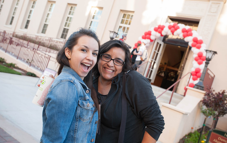 Happy faces in front of Donohoe Alumni House, location of Family Weekend check-in. Photo by Charles Barry image link to story