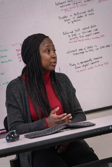 Kayla Williams talks about her database project for Community Health Partnership. Photo by Charles Barry.