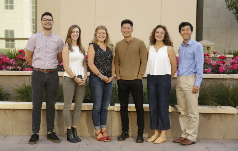 Six student Fulbright and Coro award winners posting near Charney Hall