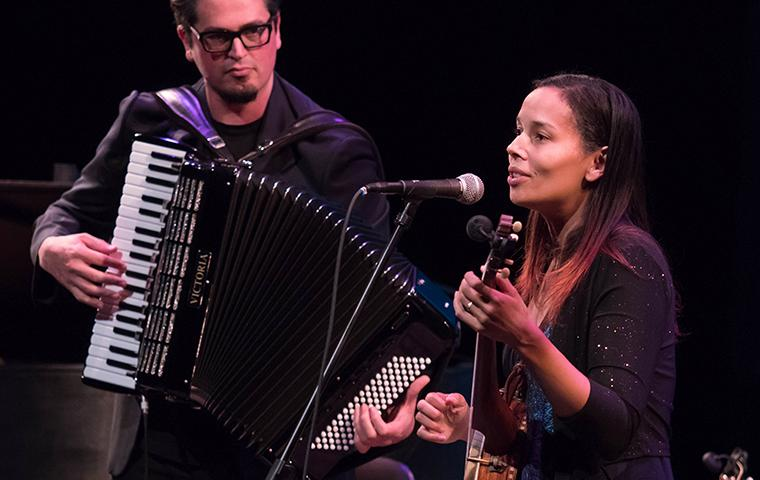 Photograph of Rhiannon Giddens performing onstage with Francesco Turrisi at SCU's Mayer Theatre. image link to article