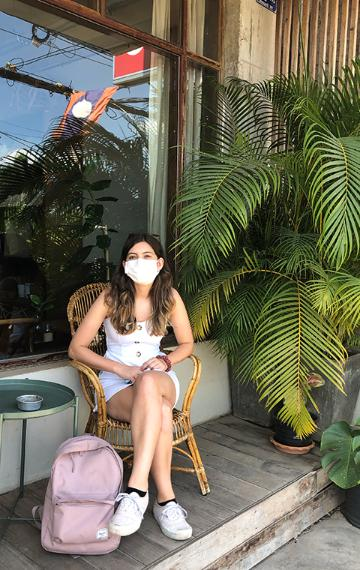 Hana Seastedt takes a break from her studies near her home in Laos.