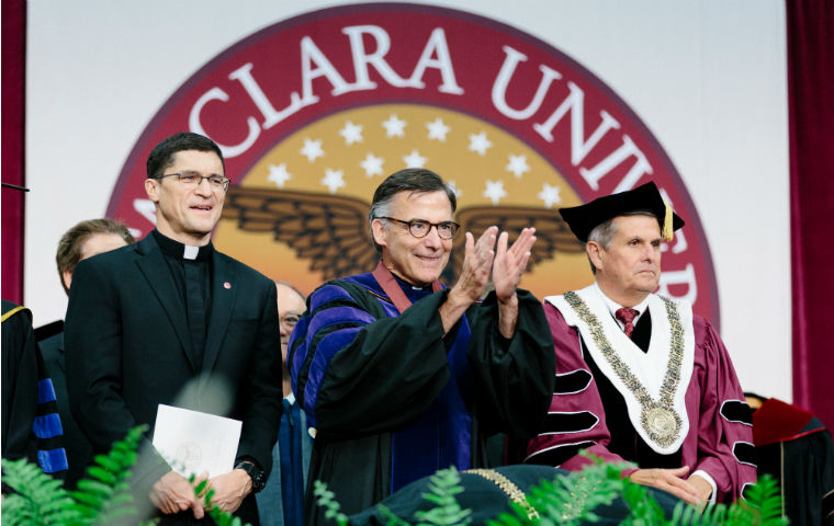 Scott Santarosa, Kevin O'Brien, John M. Sobrato on stage at inauguration in robes image link to story