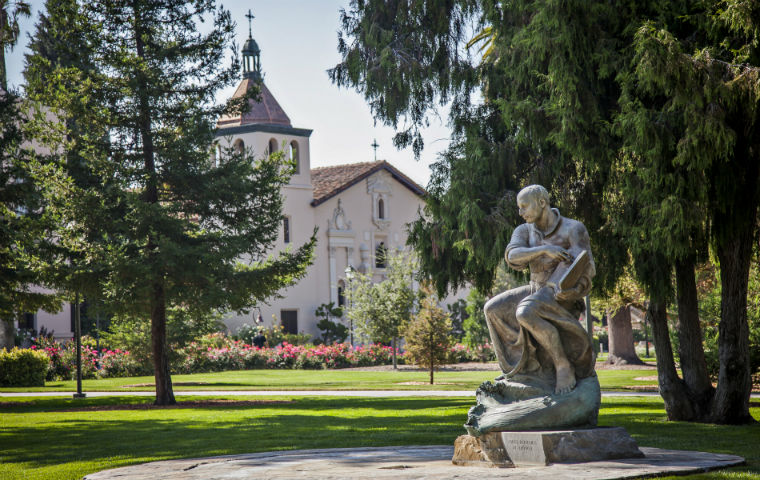 Photo of St. Ignatius statue w/ Mission Church in background image link to story
