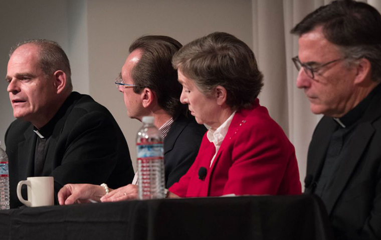 Fr. Brendan McGuire, left, speaks during an Oct. 9 panel discussion at Santa Clara University. Other panelists included, from left: Thomas Plante; Sally Vance-Trembath; and Jesuit Fr. Kevin O'Brien.