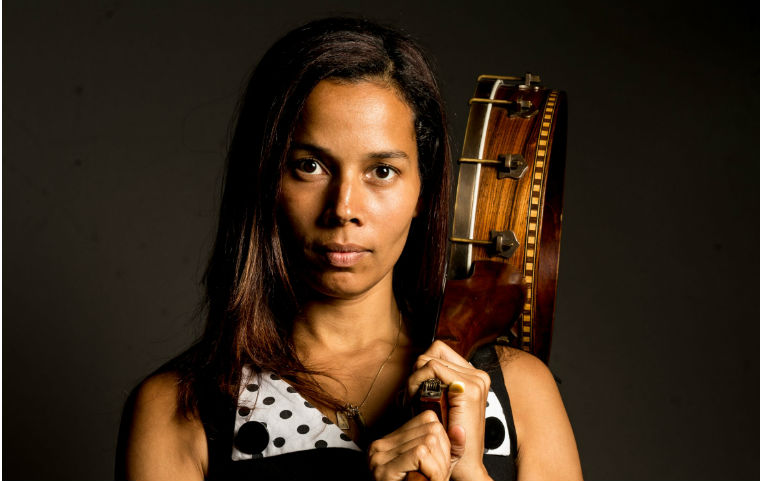 Rhiannon Giddens holding banjo over shoulder