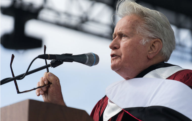 Martin Sheen speaking at 2019 commencement image link to story
