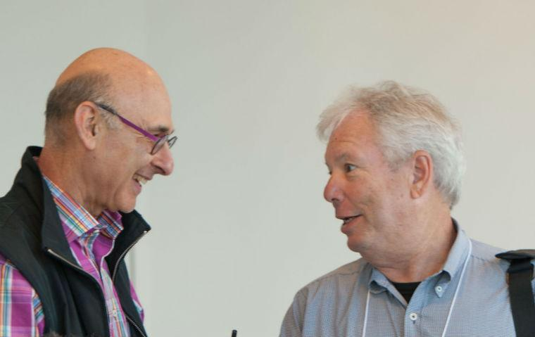 Hersh Shefrin and Richard Thaler greeting each other at a conference