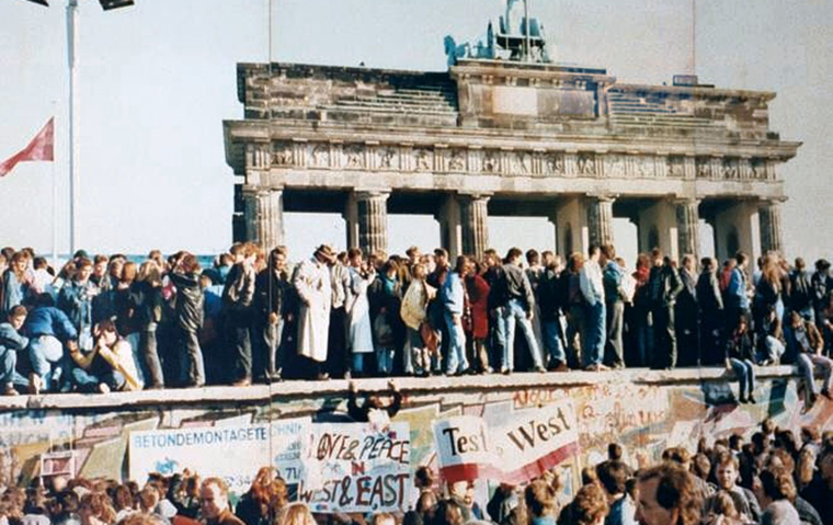 The Fall of the Berlin Wall, 1989. The photo shows a part of a public photo documentation wall at the Brandenburg Gate, Berlin.  image link to story