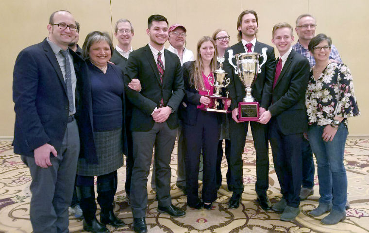 Students and coaches pose with Ethics Bowl trophy in Chicago image link to story