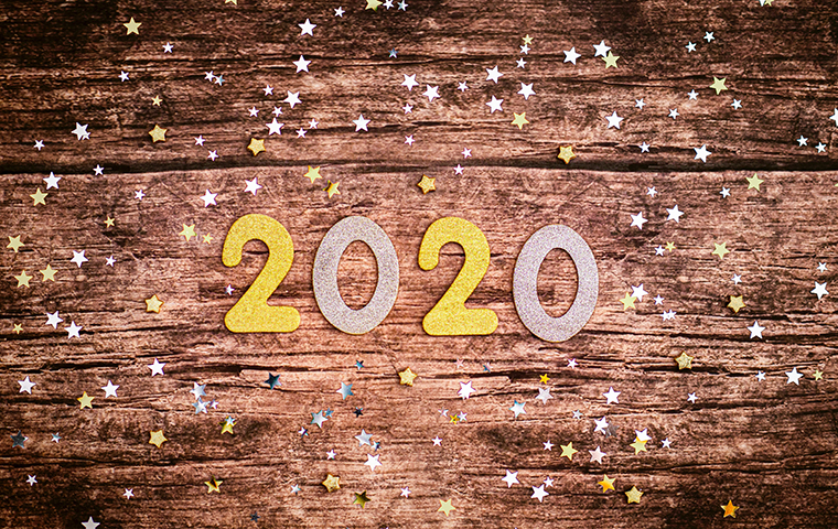 Gold and silver cutouts of the year 2020 with small stars surrounding it.  image link to story